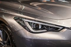 Headlight of grey modern car with LED light. Close-up royalty free stock photos