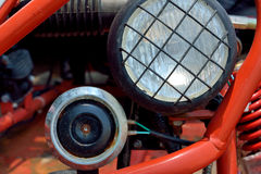 Headlight and horn of sports motor. Hedlight and horn of a sport motorcycle, which color and shape is interesting, shown as sports and outdoor travel concept, or Royalty Free Stock Photos