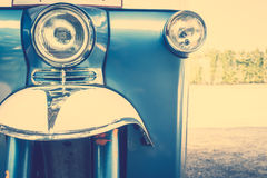 Headlight lamp. In front of vintage car - Vintage Filter Royalty Free Stock Photos
