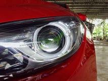 Headlight lamp transformers. Automobile beauty car closeup design glass luxury lamplight Stock Images