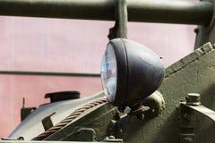 Headlight on military heavy armored vehicles. steampunk detail background. Headlight on military heavy armored vehicles. Head light on the front of a self stock photos