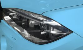 Headlight of a modern blue sport car. The front lights of the car. Modern Car exterior details. Stock Images