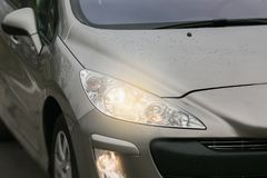Headlight of a modern car. The front lights of the car. Modern Car exterior details. Car detailing Stock Photos