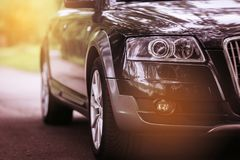 Headlight of a modern car. The front lights of the car. Modern Car exterior details. Headlight of a modern grey sport car. The front lights of the car. Modern Royalty Free Stock Images