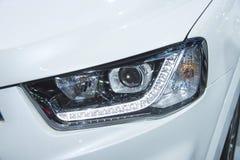 Headlight of a modern luxury car Royalty Free Stock Photo