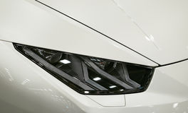 Headlight of a modern sport car.The front lights of the car. Modern Car exterior details. Royalty Free Stock Photos