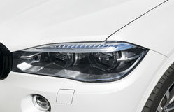 Headlight of a modern sport car. The front lights of the car. Modern Car exterior details. Royalty Free Stock Images
