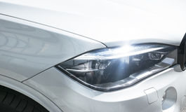 Headlight of a modern sport car. The front lights of the car. Modern Car exterior details. Royalty Free Stock Photography