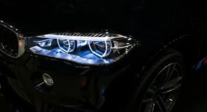 Headlight of a modern sport car. Front view of luxury sport car. Car exterior details. The front lights of the car. Royalty Free Stock Image