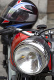 Headlight of a motorbike with a helmet Royalty Free Stock Photo