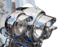 Headlight of Motorcycle. Shiny headlight of big motorcycle. Isolated over white Royalty Free Stock Photos
