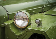 Headlight on a old military vehicle. Stock Photos