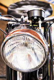 Headlight of an old motorbike Royalty Free Stock Images