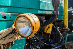 Headlight of old vehicle closeup. Colorful background of aged re Royalty Free Stock Photos