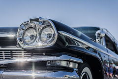 Headlight of a oldtimer in front of blue sky Royalty Free Stock Images