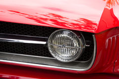 Headlight of a oldtimer red car in the street Royalty Free Stock Image