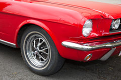 Headlight of a oldtimer red car in the street Stock Photo
