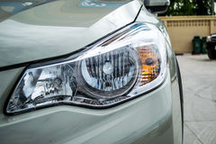 Headlight a powerful light at the front of a motor vehicle Stock Photo