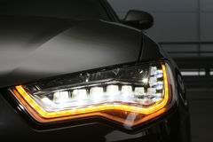 Headlight of prestigious car close up stock images