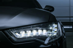 Headlight of prestigious car close up Stock Image