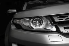 Headlight of prestigious car closeup Royalty Free Stock Photo