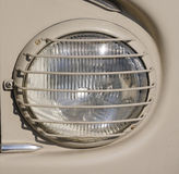 Headlight  with protective grid closeup Royalty Free Stock Photo