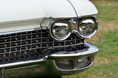 Headlight and radiator grill Stock Photos