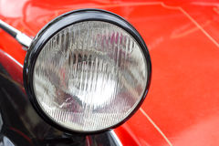 Headlight of a red car Stock Photo