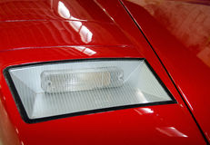 Headlight of a red sport car Stock Image