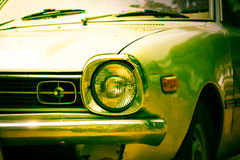 Headlight of retro car,vintage filtered Royalty Free Stock Photography
