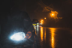 Headlight and road in the dark stock image
