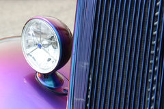 Headlight section of old car. Cropped headlight section of old/sporty car Stock Images