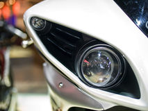 Headlight of sport bike. Royalty Free Stock Photo
