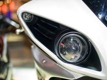 Headlight of sport bike. Close-up photo of sport bike's headlight Royalty Free Stock Photo