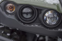 Headlight triple quad bike, color green, winter, holiday `Seeing off winter`, Surgu Square stock images