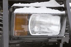 Headlight of a truck on the frozen winter ourdoor - cold outdoor Stock Image
