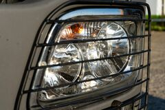 Headlight of a truck with a protective grill