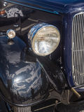 Headlight of vintage classic cars taking part in a trail run in Stock Image