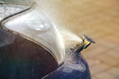 Headlight washer system. Car headlight washer system in its work Stock Photo