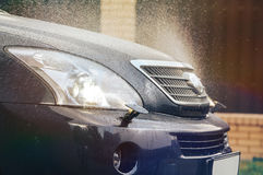 Headlight washer system. Car headlight washer system in its work Stock Images