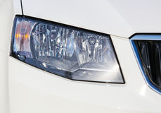 Headlight of white car close up Royalty Free Stock Photo
