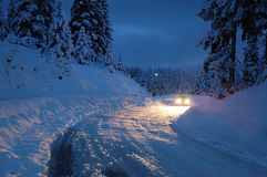 Headlights. Car headlights in snowy night Royalty Free Stock Image