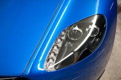 Headlights. LED running lights headlights on a sports car stock images