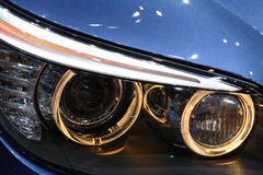 Headlights. Front headlights of a luxurious sports cars. No logo shown royalty free stock photos