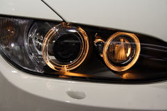 Headlights. Front part of the car. Dipped headlights are engaged royalty free stock photography