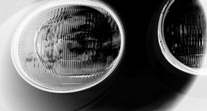Headlights. Black and white photo of round headlights of a car Royalty Free Stock Photography