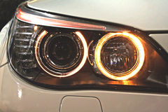 Headlights. Front part of the car. Dipped headlights are engaged stock image