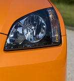 Headlights. On an orange car Royalty Free Stock Image
