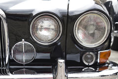Headlights of a black car. Closeup to the headlights of an old black car. Stock photography Stock Photography
