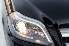 Headlights of black car Stock Photo